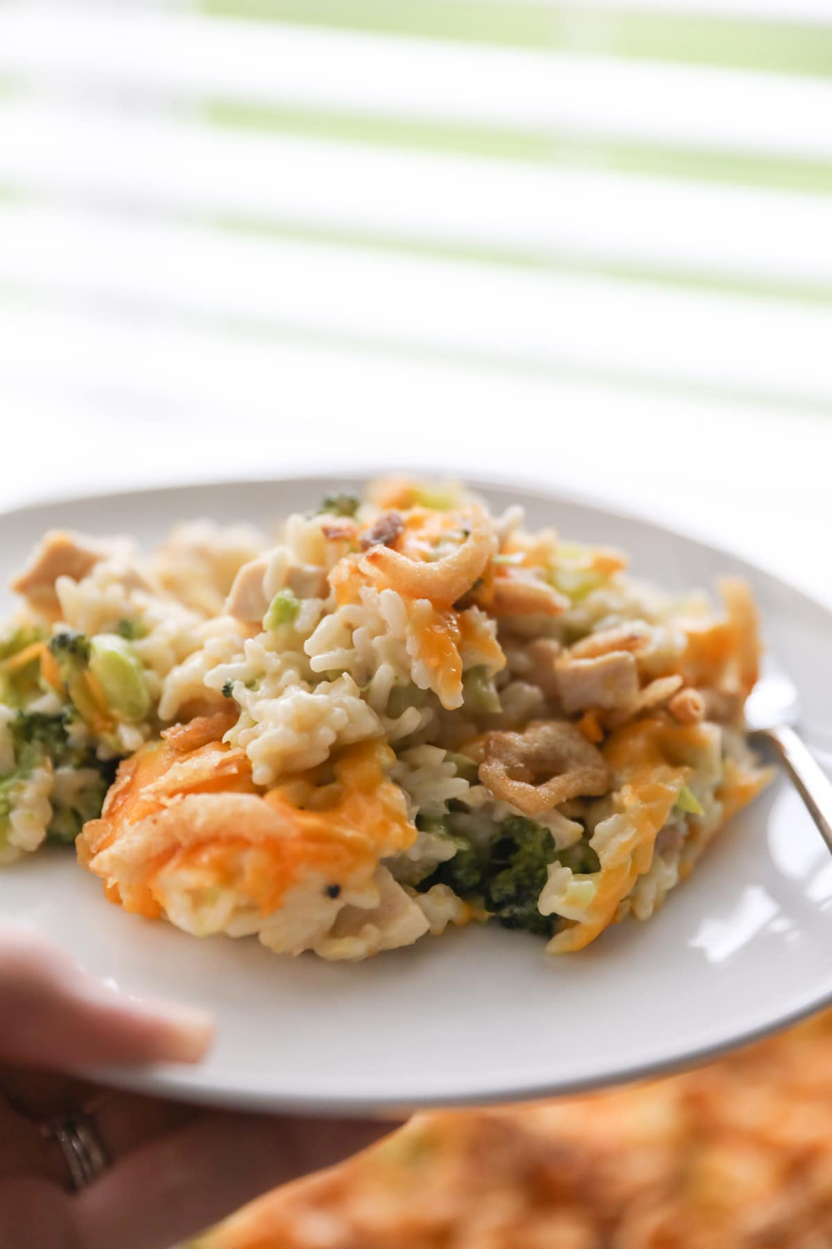 turkey casserole on white plate with fork
