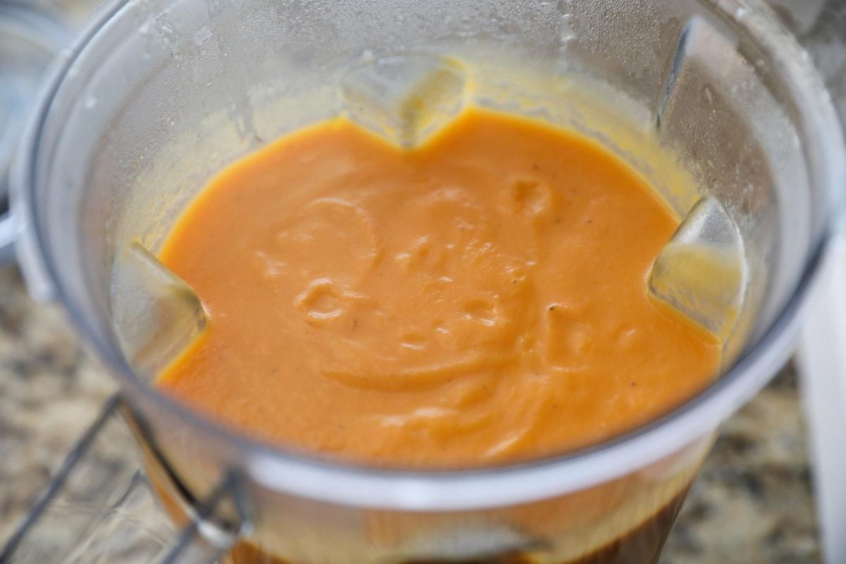 blended carrot soup in blender