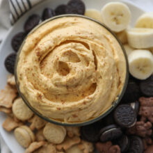 pumpkin dip with cookies and bananas around it