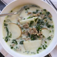sausage kale soup in white bowl