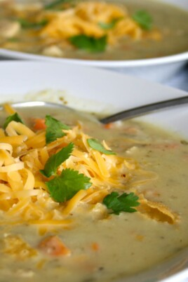 green chile soup in bowls
