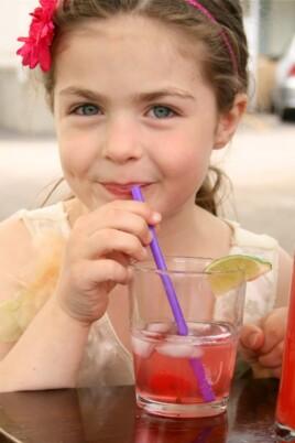 girl drinking cherry limeade