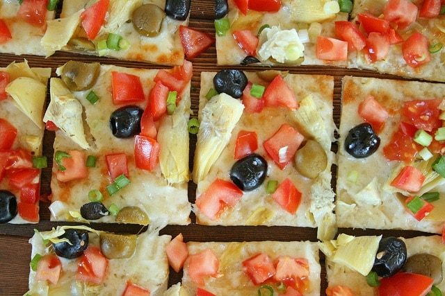 top down view of cut squares of Mediterranean Pizza