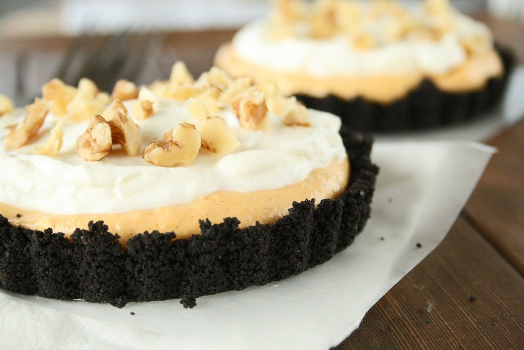 Oreo Crust with creamy pumpkin pie filling, topped with whipped cream and nuts