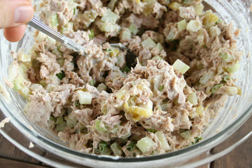 stirring tuna salad in bowl