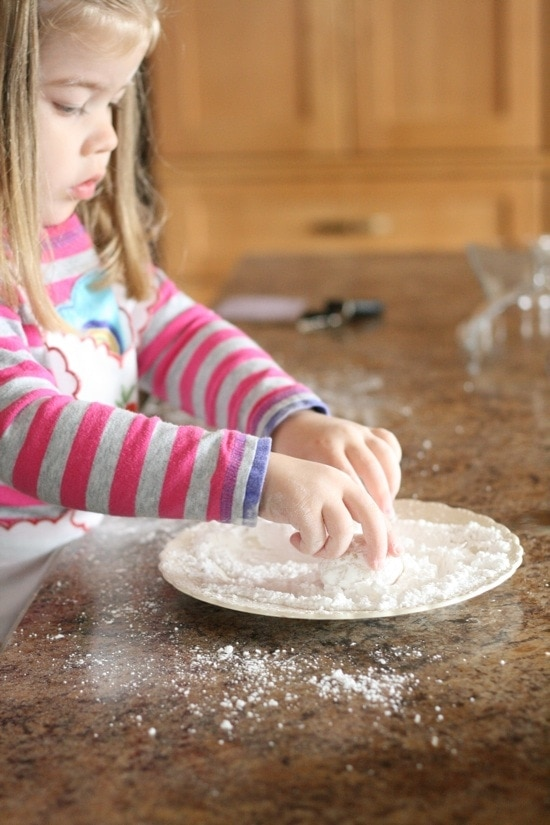 Brooke Helping Roll the Dough in Powdered Sugar
