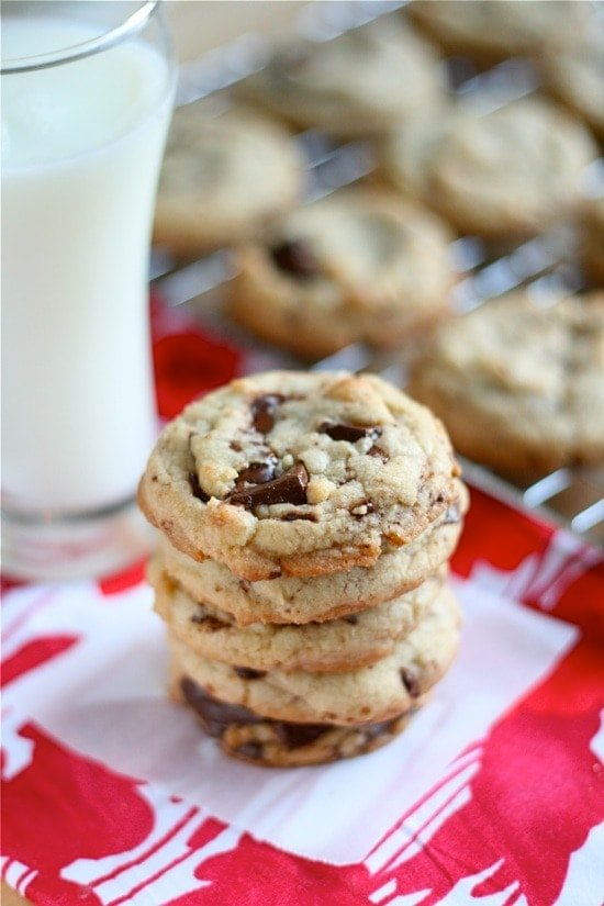 Dark Chocolate Chip Cookies stacked on top of each other on a napkin