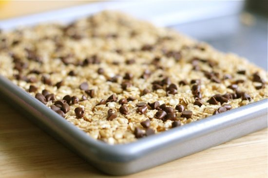 press homemade granola bars into pan