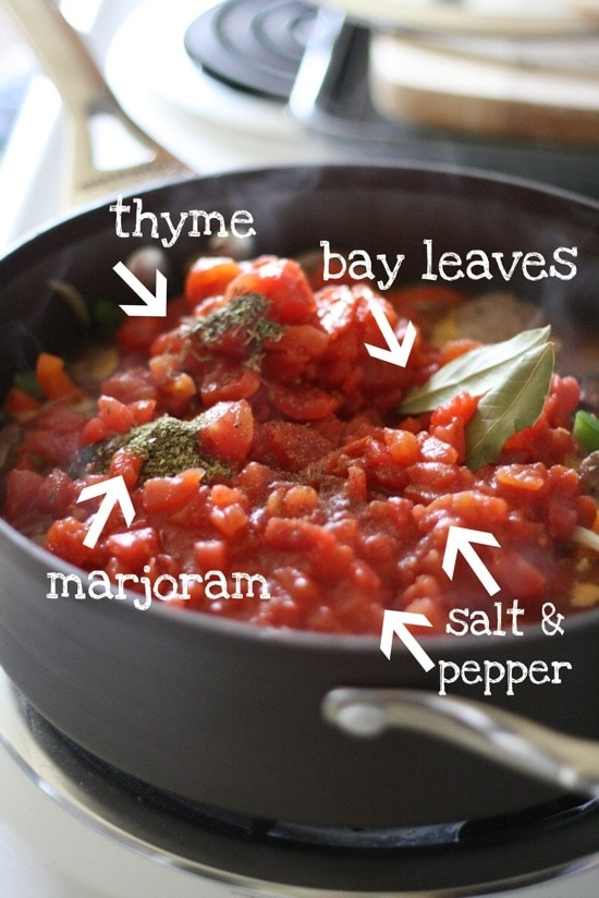 Thyme, marjoram, bay leaves, salt and pepper in pan with other ingredients