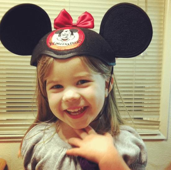 A little girl wearing a hat