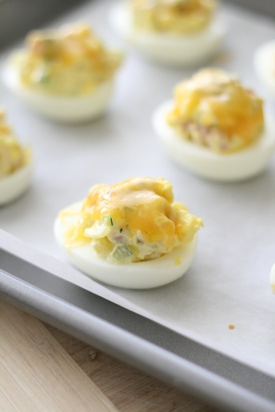 Deviled Eggs Topped with Melted Cheese