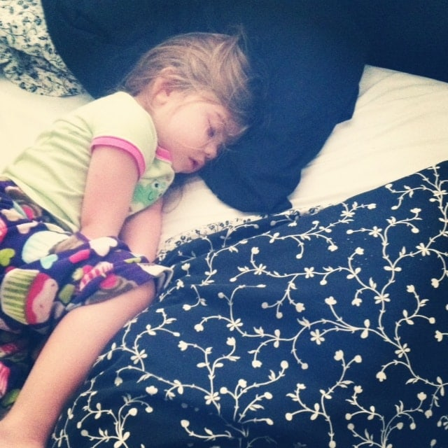Brooke sleeping on a bed