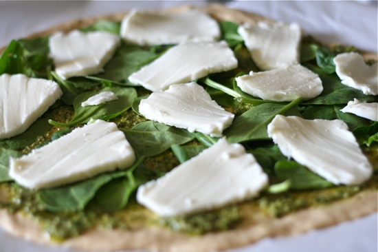 Basil and mozzarella a top of pizza