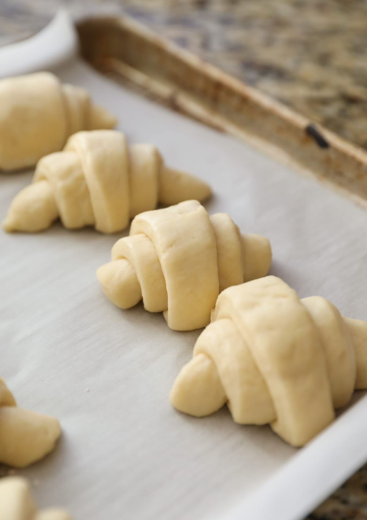 rolled crescent rolls on baking sheet