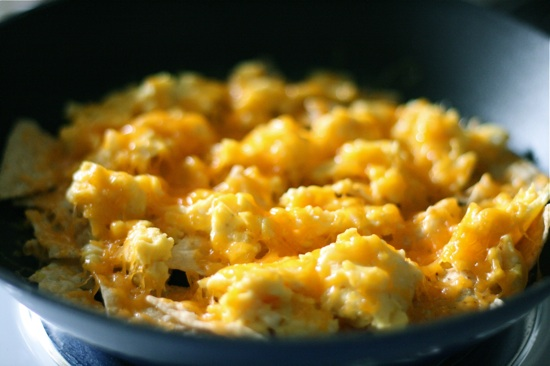 Melted cheese on top of eggs