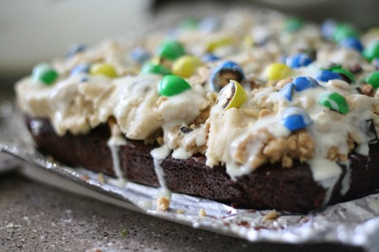 Cookie dough brownies with m&m's and a white chocolate drizzle