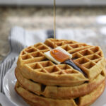 pouring syrup on pumpkin waffles