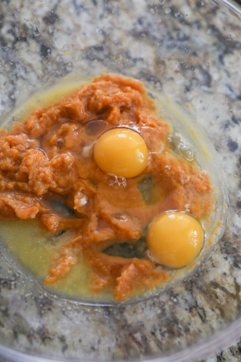 pumpkin, eggs and melted butter in glass bowl