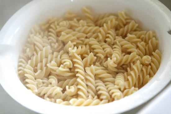 Cooked pasta in colander