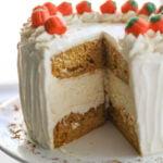 slice taken out of large pumpkin cheesecake cake