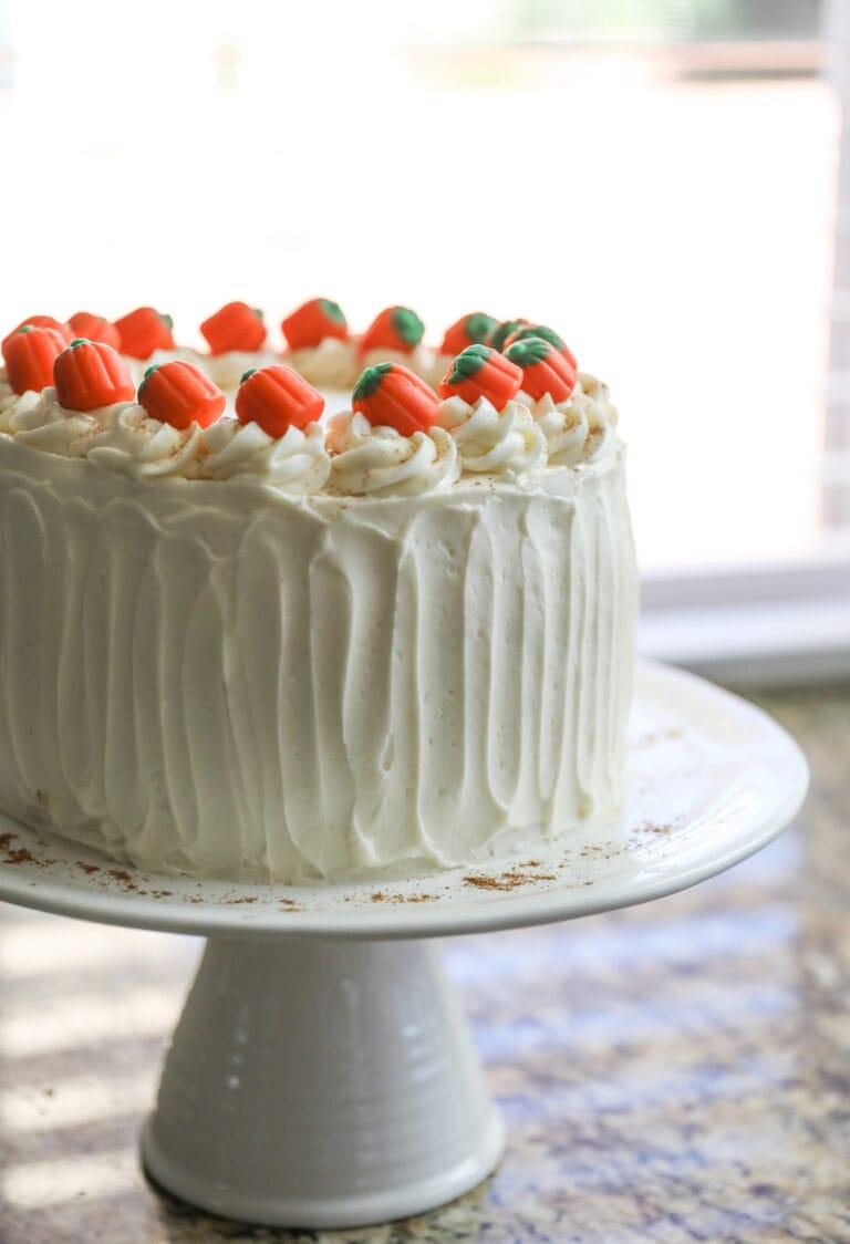 pumpkin cheesecake cake on white cake stand