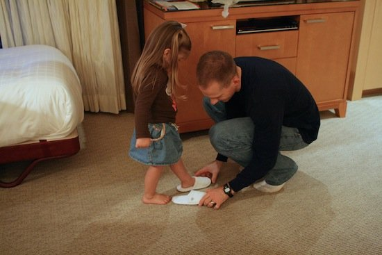 Gordon helping Brooke put on slippers