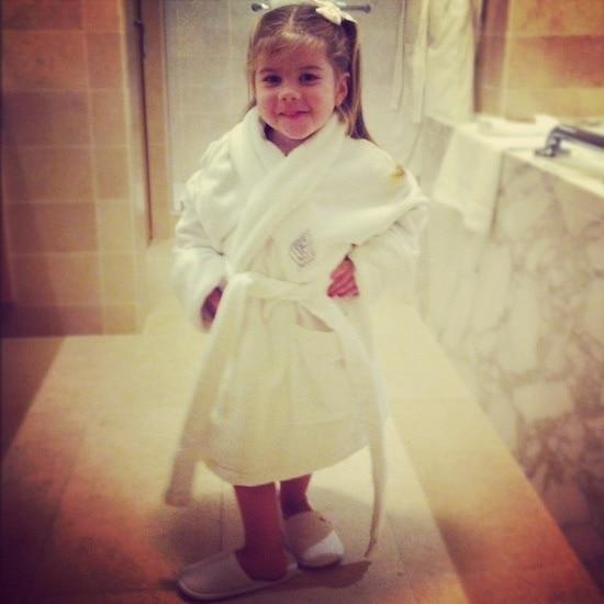 Brooke in a bathrobe and slippers