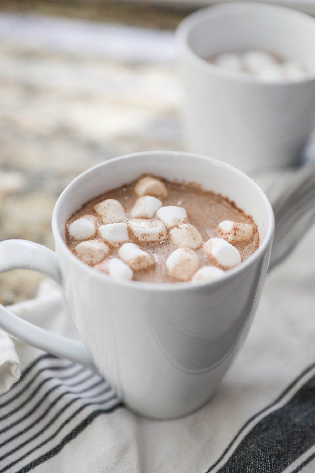 mexican hot chocolate in white mug with marshmallows