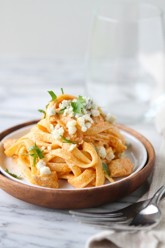 buffalo chicken pasta in a ceramic bowl in a wooden bowl