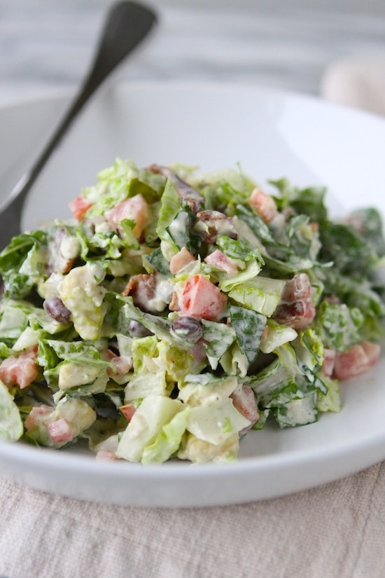 Bacon Blue Cheese Chopped Salad in a white bowl with a fork