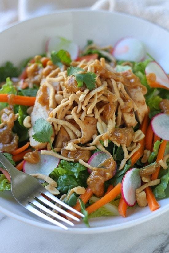 thai chicken salad in a white bowl