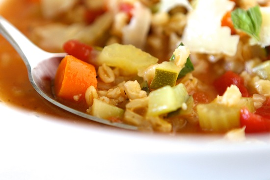 taking a spoonful of vegetable stew