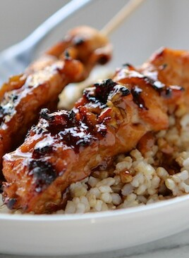 chicken skewers over rice