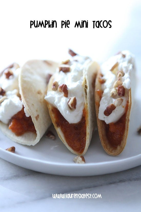 three homemade taco shells filled with pumpkin pie filling and topped with whipped cream and pecans