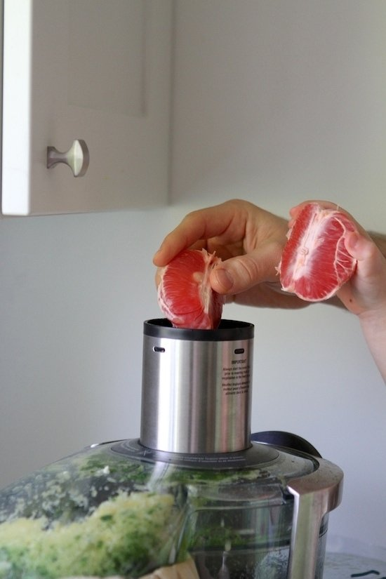 adding grapefruit to juicer