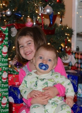 brooke and blake in front of christmas tree