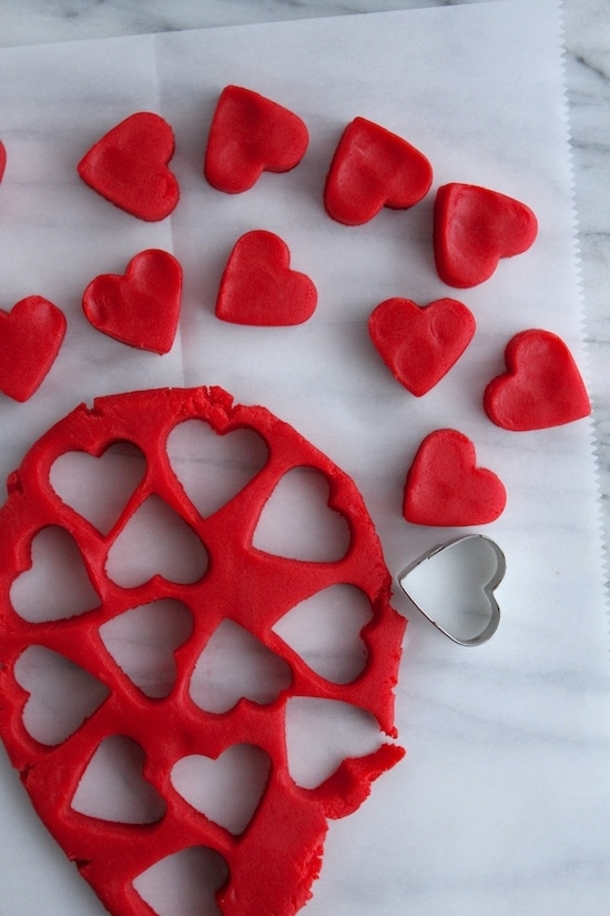 cut out red dough into hearts