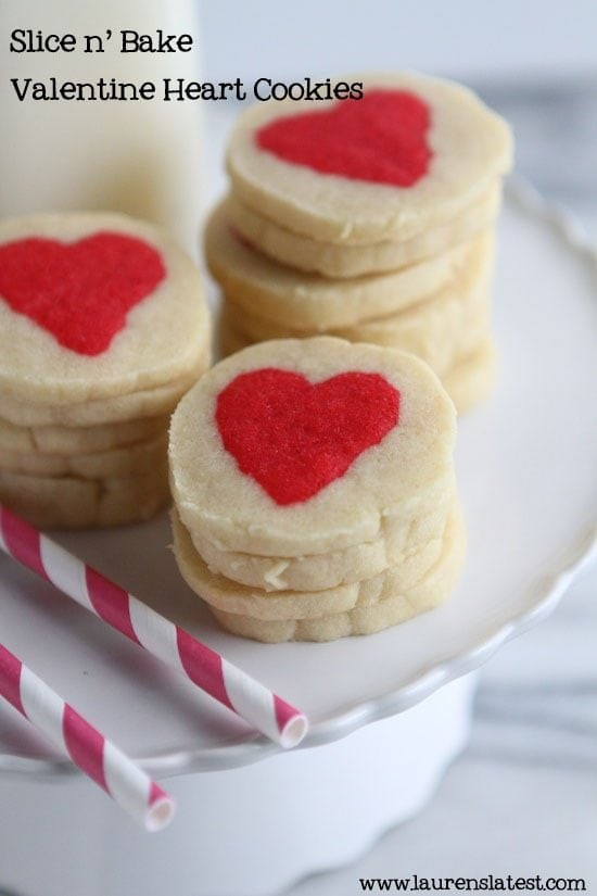 valentine's slice and bake cookies stacked on top of each other on a white cake plate