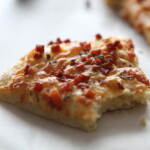 bite out of pancetta pizza