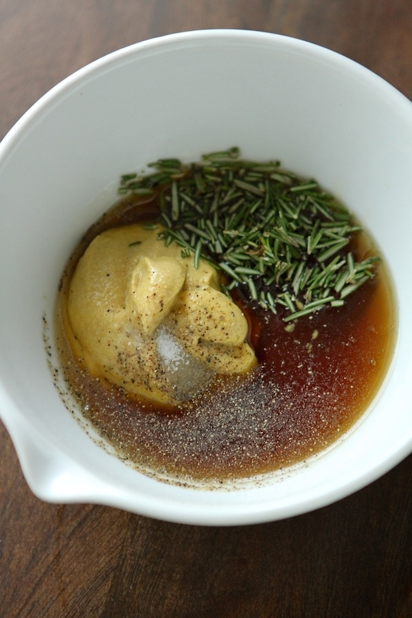 Rosemary, maple, mustard salt and pepper in a bowl