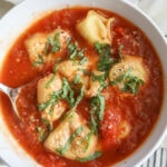 tortellini soup in white bowl