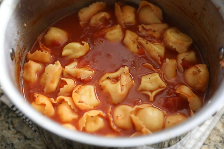 tomato basil tortellini soup in silver pot