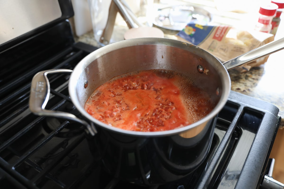 tortellini soup simmering in pot on stove