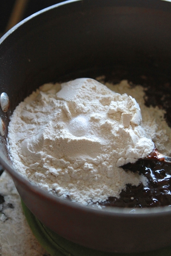 adding dry ingredients to batter