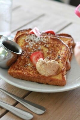 french toast with butter, powdered sugar and strawberries