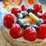 fruit waffle breakfast pizza with powdered sugar