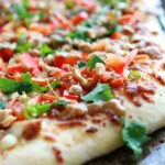 close up of thai pizza with toppings on it