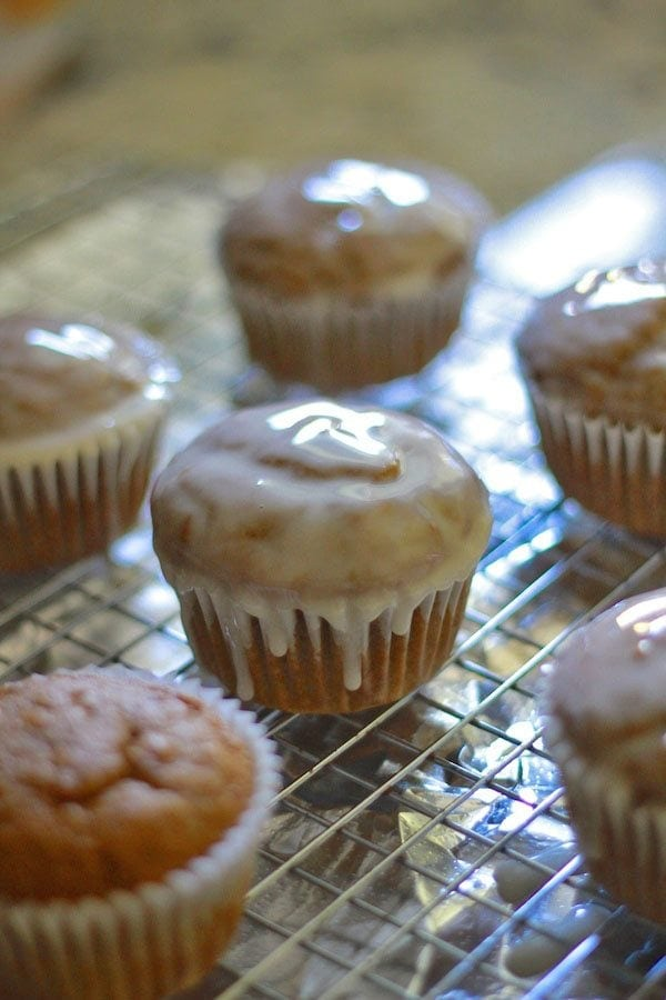 glazed pumpkin bran muffins on a cooling wrack