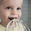 little boy licking a whisk