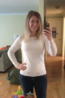 woman mirror selfie with a sweater